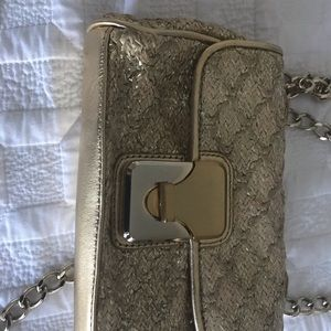Gold. Guess by Marciano purse gold chain